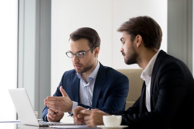 business coach mentoring client to use new daily habits