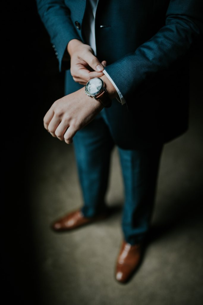 man-in-suit-checking-his-watch