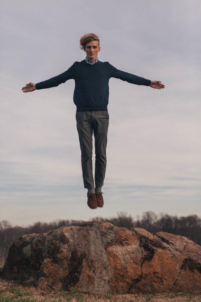 man-levitating-over-some-rocks