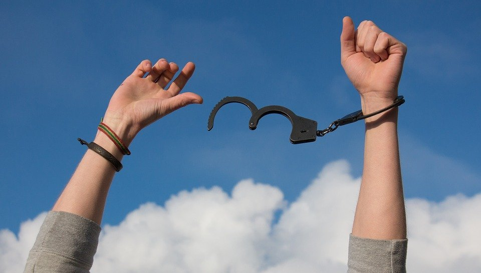 man-freeing-himself-from-handcuffs