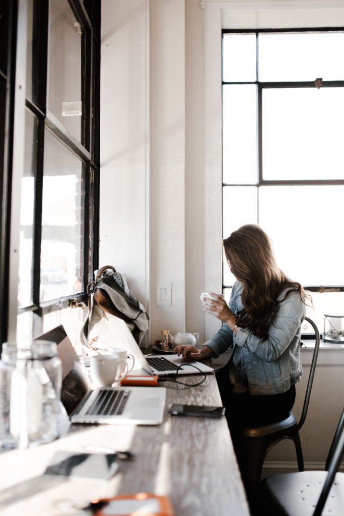 girl-working-on-laptop-at-desk