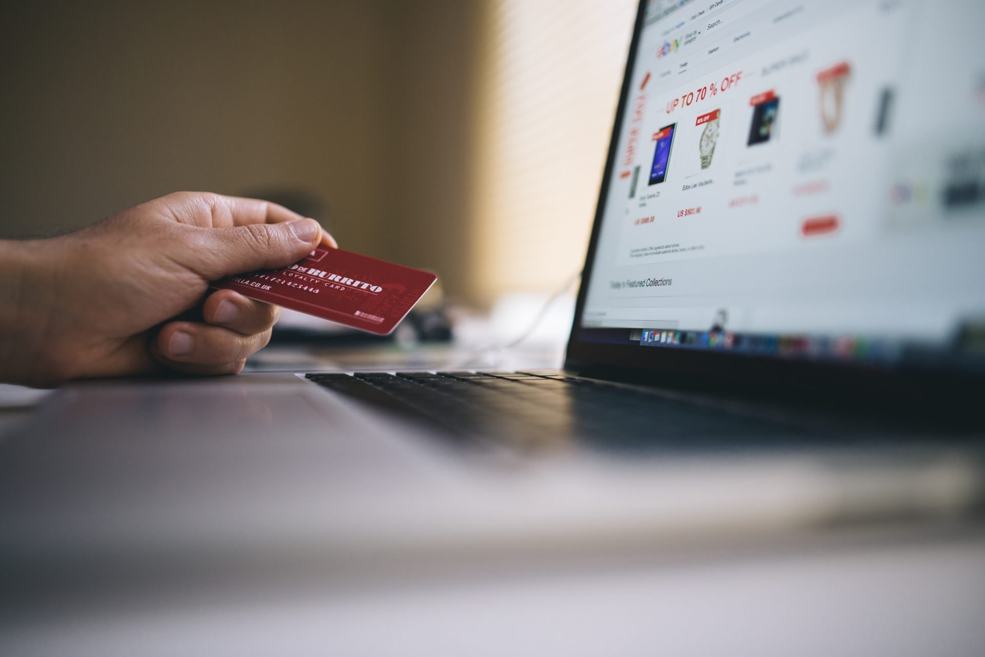 man-holding-credit-card-and-shopping-online